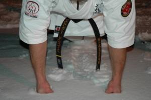 Budo Karate black belt doing push-ups in the snow